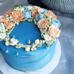 Sahara Blue cake with beige and blue flowers