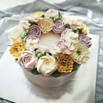 purple and yellow buttercream wreath cake