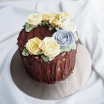 Woodland themed with large buttercream roses 6""