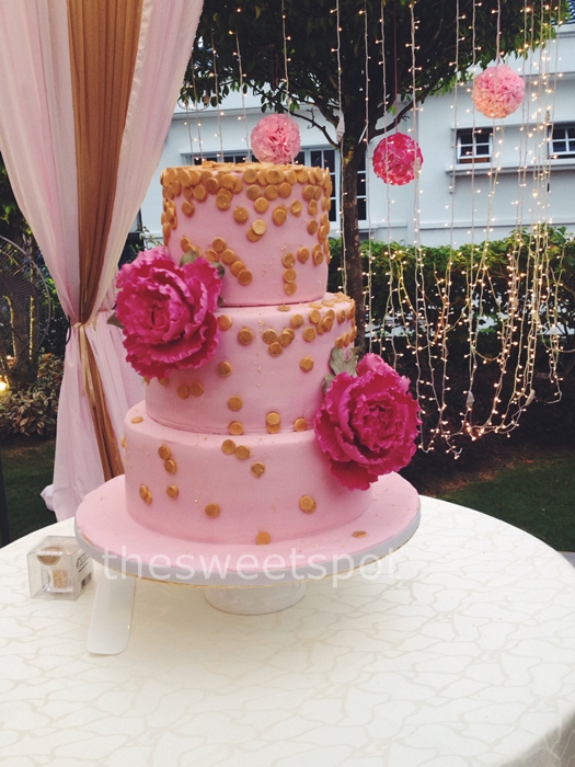 Pink & gold wedding cake with peony