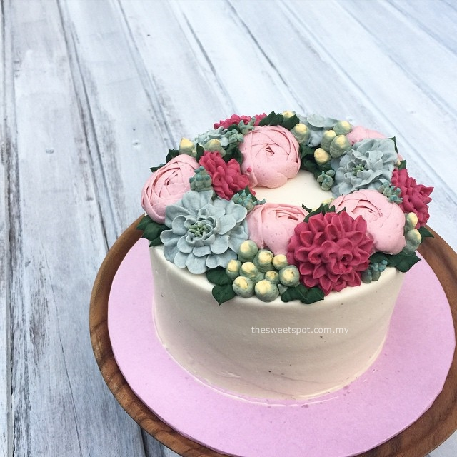 blue, pink and fuschia buttercream flower cake