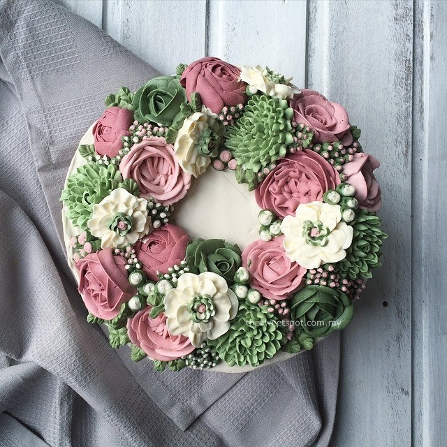 green, cream and pink buttercream flower cake
