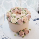 Warm brown and pale pink buttercream cake 6""