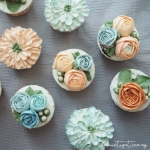 blue and orange buttercream flower cupcakes