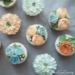 blue and orange buttercream flower cupcakes