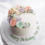 "6"" Crescent buttercream flower cake"