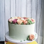 pink, mint and coral buttercream flower wreath cake