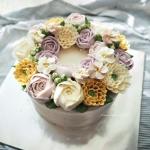 purple and yellow buttercream wreath cake